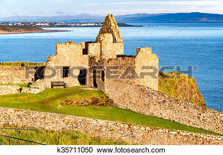 Stock Photography of Ruin of Dunluce castle and Portrush in.