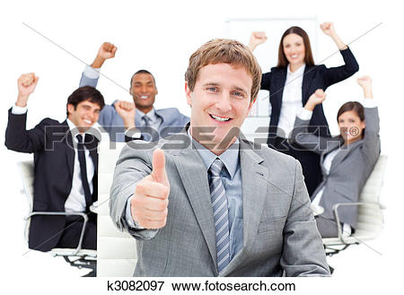Picture of Positive business team showing thumbs up k3082097.