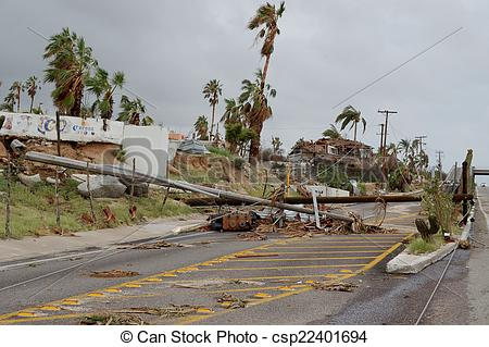 Stock Photographs of Broken by hurricane electric wooden post.