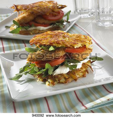 Stock Photo of Potato cake, soft cheese and chicken burger 940092.