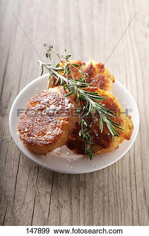 Stock Photograph of Potato cakes with Fleur de sel sea salt and.
