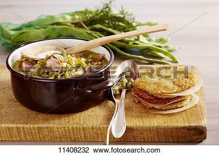Stock Photo of Bouneschlupp mit Gromperekichelcher (bean soup with.