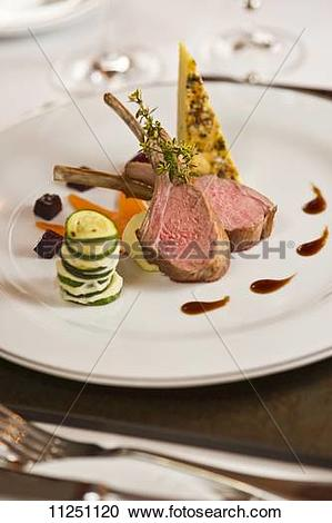 Stock Photography of Lamb chops with a courgette and pumpkin.