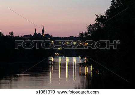 Stock Photography of Bridge over a river litup at dusk, Key Bridge.