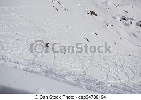 Stock Photographs of freeride skier skiing in deep powder snow.
