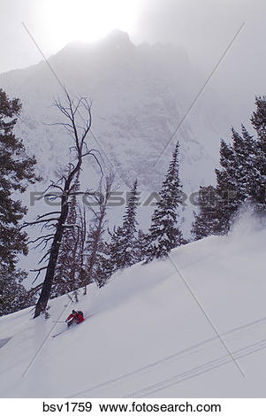 Stock Photograph of A man skiing powder snow in the Sawtooth.