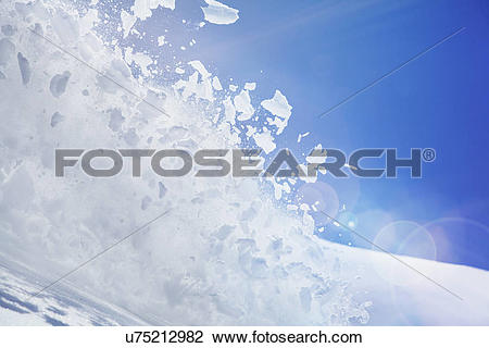 Stock Photo of Close up of snow covered hill with powder snow and.