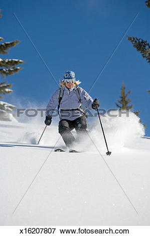 Picture of USA, Idaho, Sun Valley, woman skiing in powder snow.