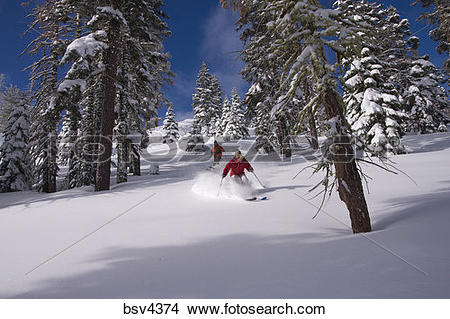 Stock Photo of A man and woman skiing powder snow at Northstar at.