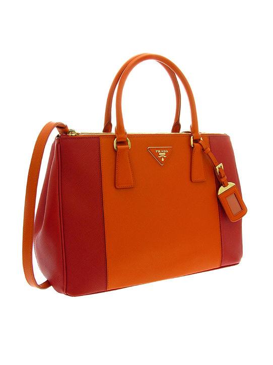 big orange prada bag, prada canvas and leather tote.