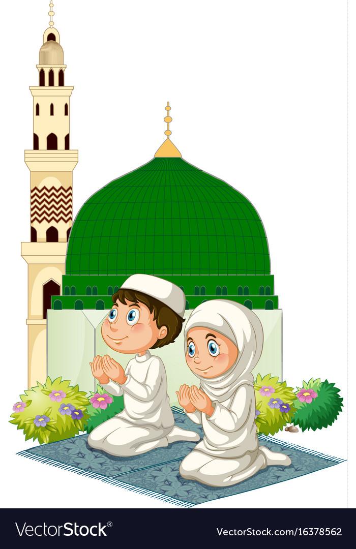 Two muslim kids praying at mosque.