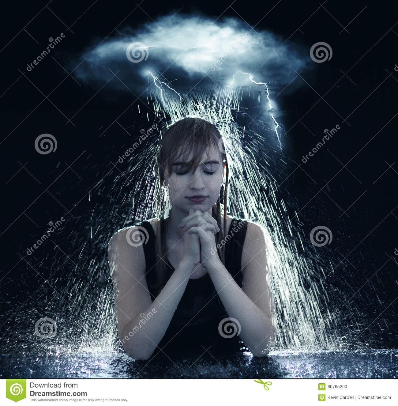 Praying Through The Storm Stock Photo.