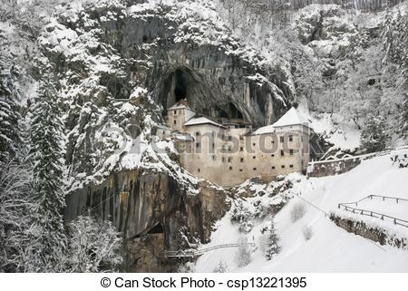 Stock Photographs of Predjama castle in the winter, Slovenia.