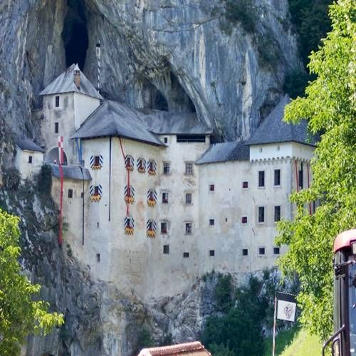 llama Castle' (Slovene: Predjamski grad or Grad Predjama, German.