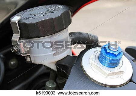 Stock Photo of Motorcycle brake oil level and preload screw.