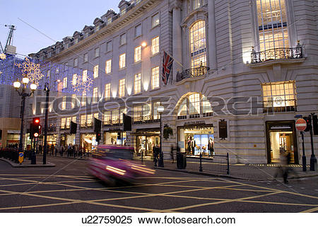 Stock Image of England, London, Regent Street, Moving traffic in.