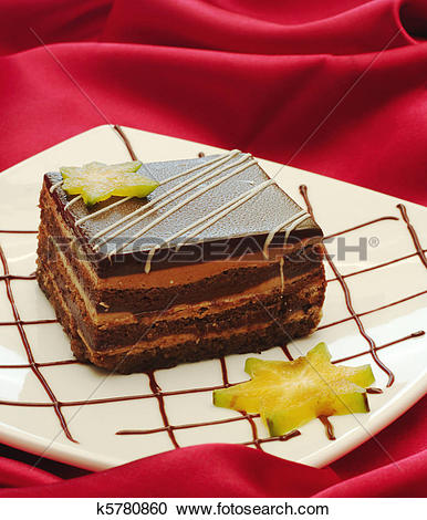 Stock Photography of Tiramisu Cake on white plate with chocolate.