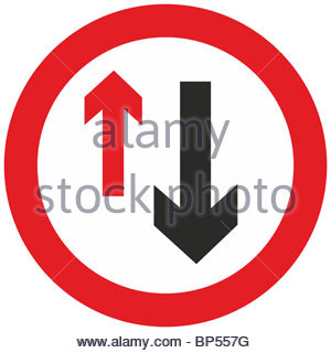 Road Sign Warning About Priority To Oncoming Vehicles Stock Photo.