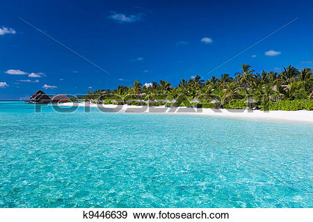 Stock Photograph of Tropical island with sandy beach and pristine.