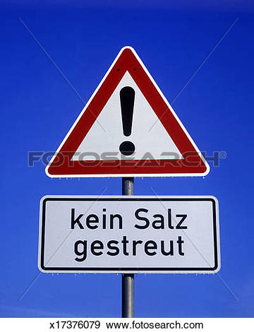 Stock Photograph of road sign, proceed with extra caution, no salt.