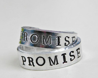 His and her promise rings.