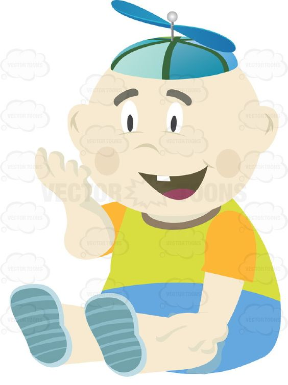 Baby Boy Sitting Down Wearing Green Shirt, Blue Shorts And.