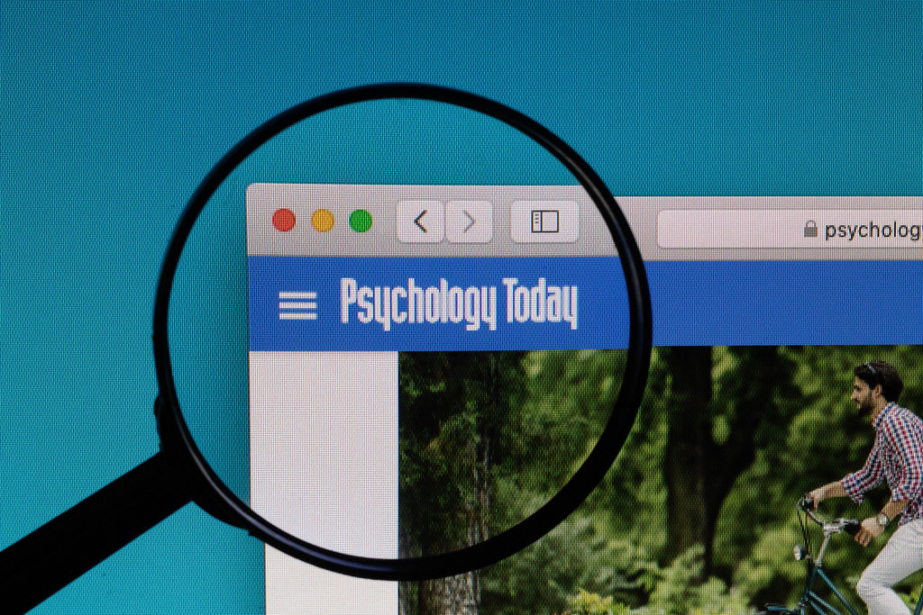 Psychology Today logo under magnifying glass.