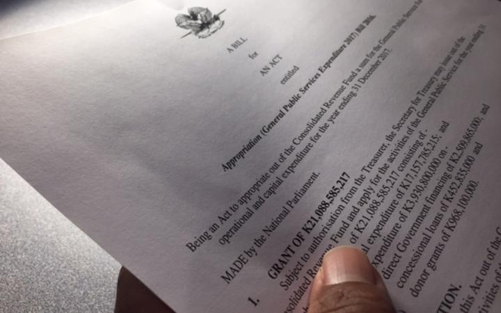 Finance Minister defends PNG govt\'s economic management.