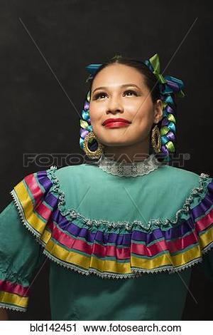 Stock Photography of Hispanic teenage girl wearing Puebla.