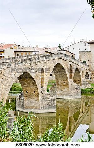 Stock Photograph of romanesque bridge over river Arga, Puente La.