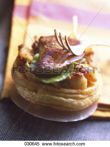 Stock Image of potato and foie gras puff pastry tartlet 030645.