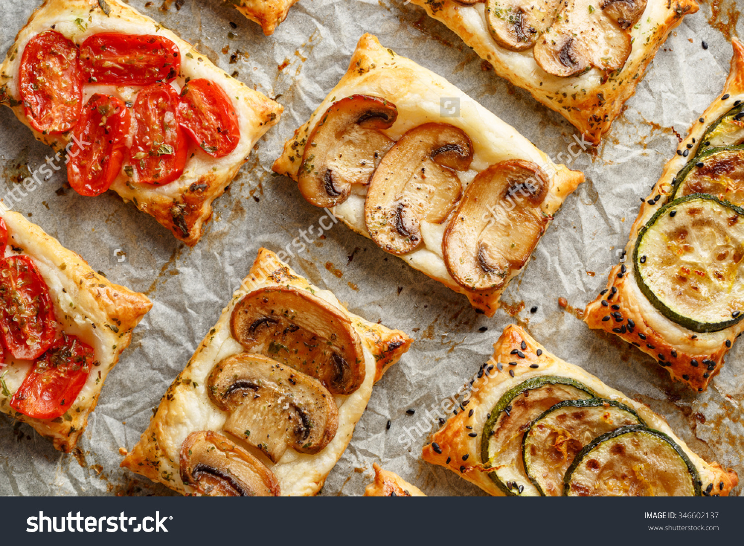 Puff Pastry Appetizers Vegetables Mushrooms Tomatoes Stock Photo.
