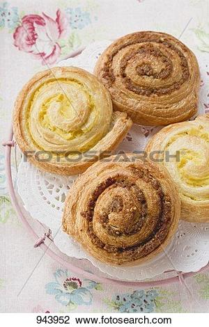 Stock Photo of Danish pastry snails with nut and custard fillings.