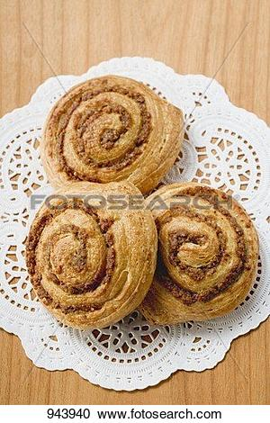 Stock Photography of Three Danish pastry snails with nut filling.