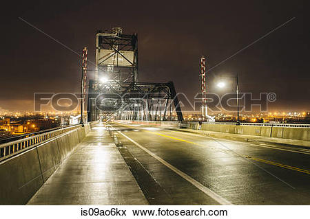 """Picture of """"Industrial bridge over Puget Sound at night, Tacoma."""