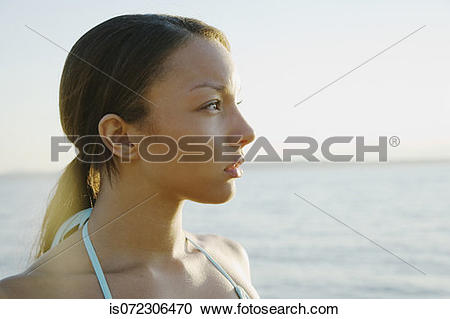 Stock Photography of Profile of African woman with hair pulled.