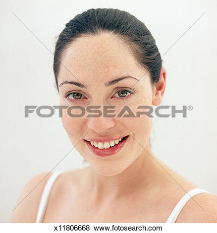 Pictures of Woman with hair pulled back, smiling, portrait, close.
