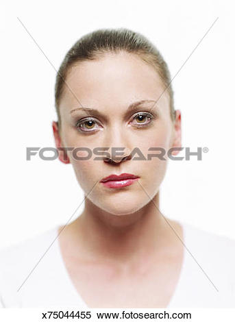Stock Image of Young woman wearing white shirt with hair pulled.