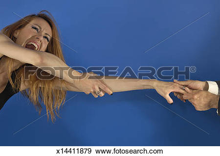 Stock Photograph of Young woman has her hand forcefully pulled by.