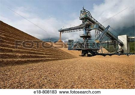 Stock Photo of Canada, BC, Port Mellon. Wood chip pile and.