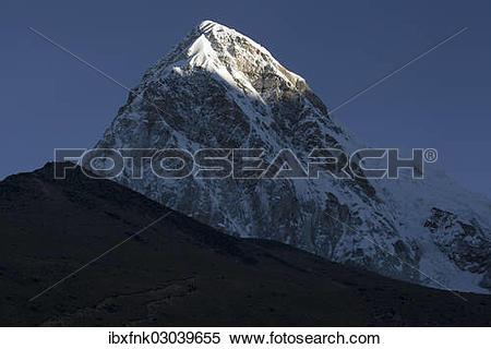 """Stock Image of """"Mountains Kalar Patthar, at front, and Pumori, at."""