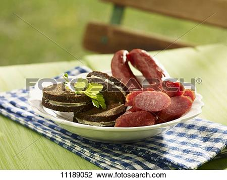 Stock Photo of Pumpernickel sandwiches with cabanossi sausage.