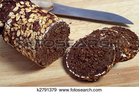 Stock Photograph of Pumpernickel bread slices and knife k2791379.