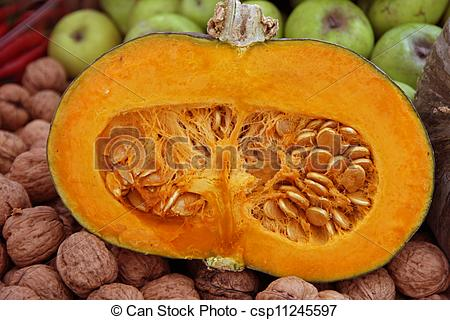 Stock Photographs of sweet orange pumpkin cut in half with the.