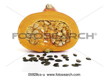 Stock Images of Half a pumpkin, pumpkin seeds in front 05928cs.