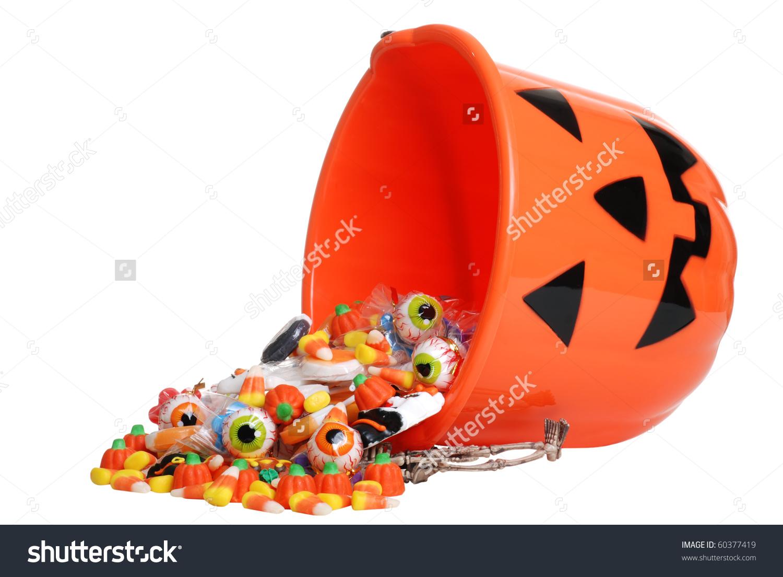 Child Halloween Pumpkin Bucket Spilling Candy Stock Photo 60377419.