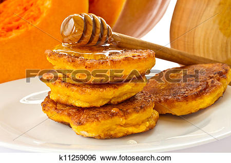 Stock Images of pumpkin pancakes with honey k11259096.