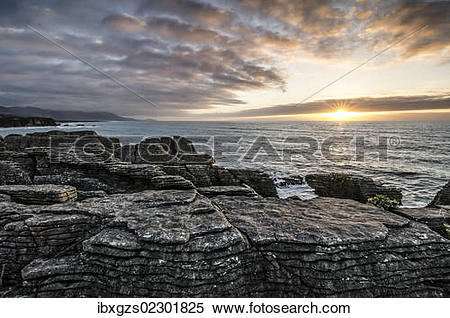 "Stock Image of ""Sunset at Pancake Rocks, Paparoa National Park."