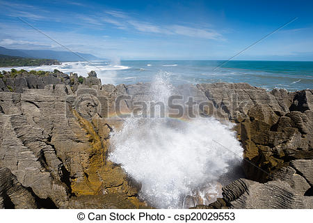Stock Images of Pancake rock splash water and rainbow, Punakaiki.