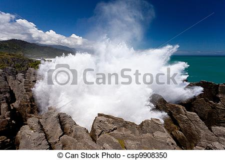 Stock Photography of Exploding surf at Pancake Rocks of Punakaiki.